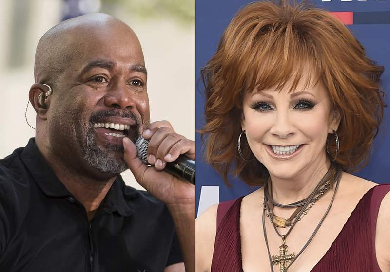 """This combination photo shows Darius Rucker performing on NBC's """"Today"""" show in New York on May 25, 2018, left, and Reba McEntire  at the 54th annual Academy of Country Music Awards in Las Vegas on April 7, 2019. McEntire and Rucker are promising laughs and good music when they co-host this years CMA Awards in November. McEntire is a veteran of awards show hosting, while Rucker will be a first-time host when the show airs on Nov. 11 on ABC from Nashville, Tenn. (AP Photo)"""