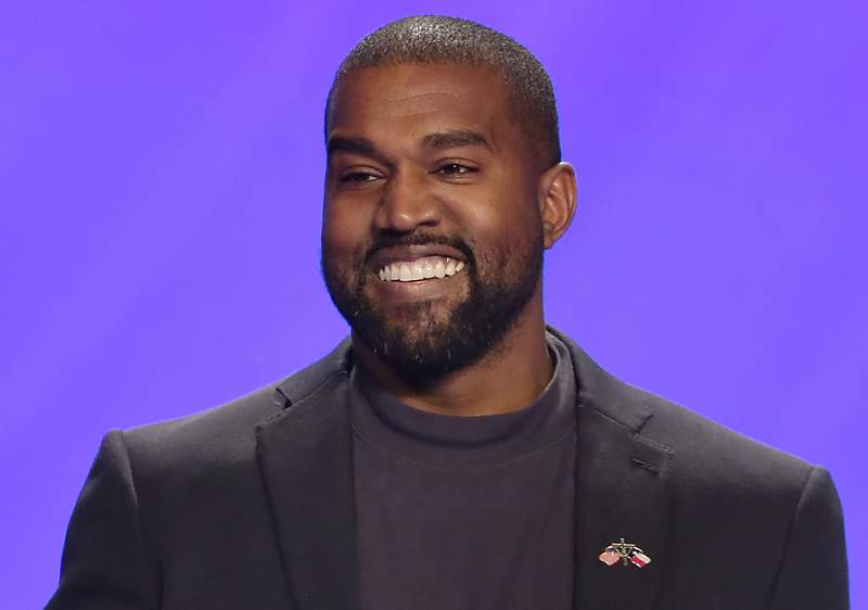 FILE - This Nov. 17, 2019, file photo shows Kanye West on stage during a service at Lakewood Church in Houston. A law firm with ties to prominent Democrats has filed a lawsuit attempting to keep West off presidential ballots in Virginia. Attorneys for Perkins Coie filed a lawsuit in Richmond on Tuesday, Sept. 1, 2020, on behalf of two people who say they were tricked into signing an Elector Oath backing West's candidacy. (AP Photo/Michael Wyke, File)