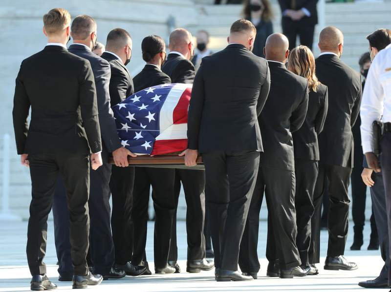 The casket containing the remains of Associate Justice Ruth Bader Ginsburg is carried at the U.S. Supreme Court where she will lie in repose, on September 23, 2020 in Washington, DC. Ginsburg who was appointed by former U.S. President Bill Clinton served on the high court from 1993 until her death on September 18, 2020. (Photo by Chip Somodevilla/Getty Images)