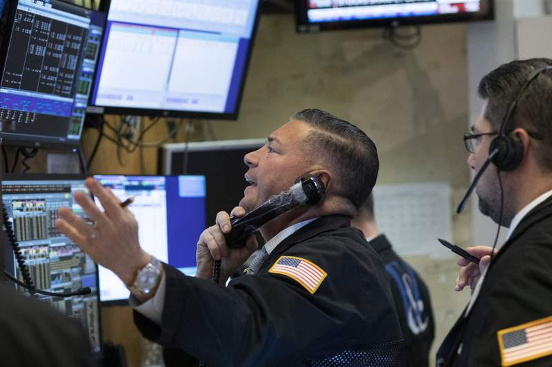 Traders work at the New York Stock Exchange as the market closes, Wednesday, March 18, 2020 in New York.  Major U.S. stock indexes closed sharply lower on Wall Street Wednesday as fears of a prolonged coronavirus-induced recession took hold.  The Dow industrials lost more than 1,300 points, or 6.3%. After a brutal few weeks, the Dow has now lost nearly all of its gains since President Trump's inauguration. (AP Photo/Mark Lennihan)