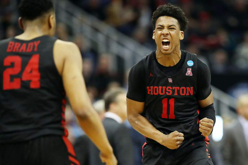 KANSAS CITY, MISSOURI - MARCH 29: Nate Hinton #11 celebrates with Breaon Brady #24 of the Houston Cougars against the Kentucky Wildcats during the 2019 NCAA Basketball Tournament Midwest Regional at Sprint Center on March 29, 2019 in Kansas City, Missouri. (Photo by Christian Petersen/Getty Images)