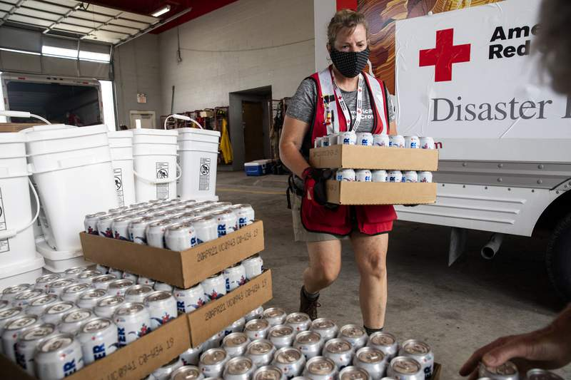 August 1, 2020. Edcouch, Texas.American Red Cross volunteer Pam Simone unloads water from Anheuser-Busch at a fire station that will be distributed to people affected by Hurricane Hanna, in Edcouch, TX on Saturday August 01, 2020.Photo by Scott Dalton/American Red Cross