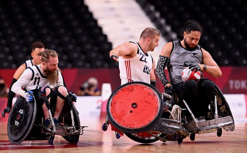 TOKYO, JAPAN - AUGUST 25: Kory Puderbaugh of Team United States tackles Hayden Barton-Cootes of Team New Zealand during the Wheelchair Rugby Pool Phase Group B match between Team United States and Team New Zealand on day 1 of the Tokyo 2020 Paralympic Games at Yoyogi National Stadium on August 25, 2021 in Tokyo, Japan.  (Photo by Alex Davidson/Getty Images for International Paralympic Committee)