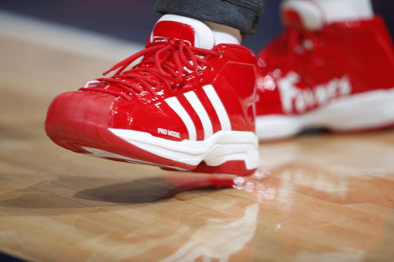 FILE - In this file photo dated Wednesday, Dec. 25, 2019, New Orleans Pelicans forward Derrick Favors wears Christmas-themed Adidas Pro Model Superstars shoes in the first half of an NBA basketball game Wednesday, Dec. 25, 2019, in Denver, USA.  Sports apparel and shoe company Adidas said Tuesday April 14, 2020, it has been approved by the German government for a 3 billion-euro ( US dollars 3.3 billion) emergency loan to help the company get through a period of lost business due to the COVID-19 coronavirus outbreak. (AP Photo/David Zalubowski, FILE)