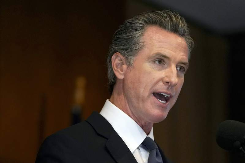 FILE - In this Sept. 14, 2021, file photo, Gov. Gavin Newsom speaks in San Francisco. California will be the first state to bar mega-retailers from firing warehouse workers for missing quotas that interfere with bathroom and rest breaks. The legislation signed Wednesday, Sept. 22, 2021 by Newsom grew from Amazon's drive to speed goods to consumers. (AP Photo/Jeff Chiu, File)