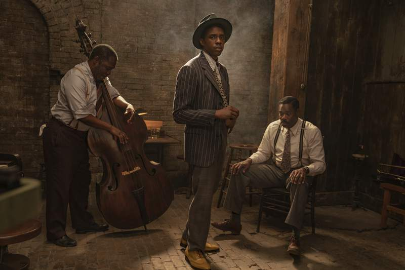 """This image released by Netflix shows Michael Potts, from left, Chadwick Boseman and Colman Domingo in """"Ma Rainey's Black Bottom.""""  (David Lee/Netflix via AP)"""