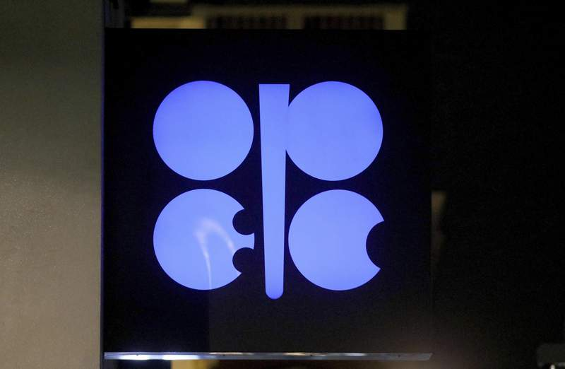 FILE - In this Dec. 19, 2019 file photo, the advertising label of the Organization of the Petroleum Exporting Countries, OPEC, shines at their headquarters in Vienna, Austria. OPEC and allied countries including Russia agreed Thursday, Dec. 3, 2020 to increase oil production by 500,000 barrels a day from January and said they would meet monthly to decide further output levels, gingerly adding more crude to a global economy still suffering from the COVID-19 pandemic. (AP Photo/Ronald Zak, File)