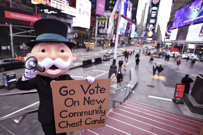 IMAGE DISTRIBUTED FOR HASBRO, INC. - Mr. Monopoly takes on NYC to get the community involved in the new Monopoly Community Chest Card Vote on Wednesday, Mar. 17, 2021 in New York. (Charles Sykes/AP Images for Hasbro, Inc.)
