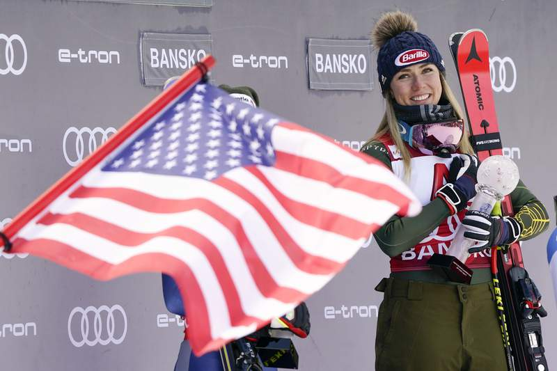 FILE - In this Sunday, Jan. 26, 2020 file photo, United States' Mikaela Shiffrin smiles on the podium after winning the alpine ski, women's World Cup super-G, in Bansko, Bulgaria. A year that turned Mikaela Shiffrins world upside-down has left the American standout wondering how much time she has left in ski racing. The double Olympic and three-time overall World Cup champion is questioning how long all the traveling will still be worth it.  (AP Photo/Giovanni Auletta, File)