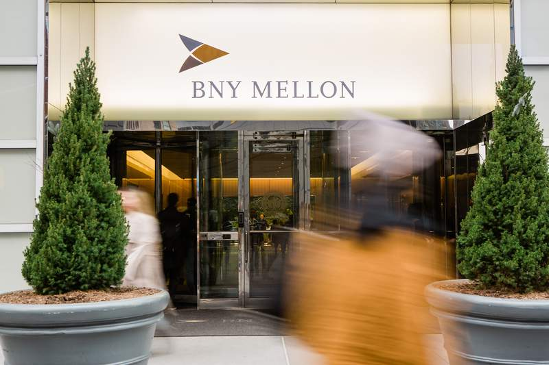 Pedestrians walk in front of a Bank of New York Mellon Corp. office building in New York, U.S., on Monday, Jan. 13, 2020. BNY Mellon is scheduled to release earnings figures on January 16. Photographer: Gabriela Bhaskar/Bloomberg via Getty Images