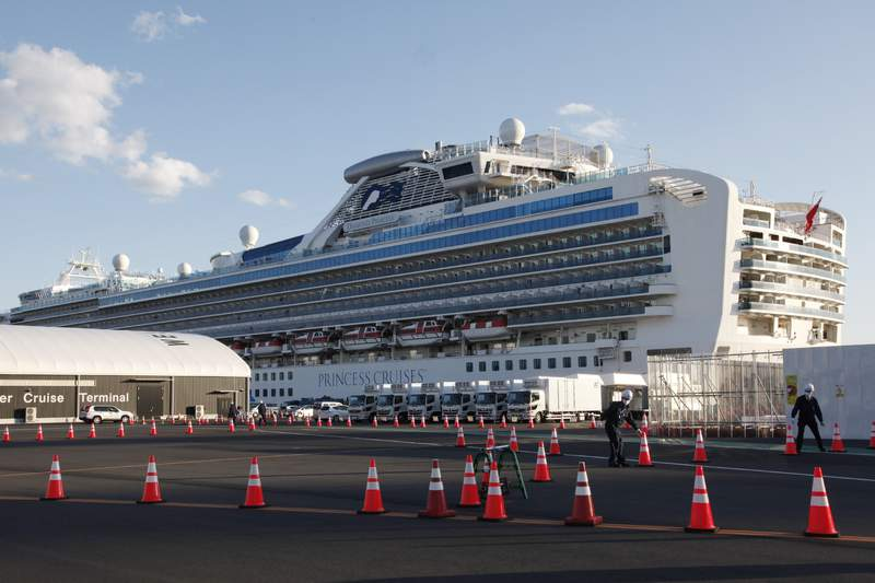 The quarantined cruise ship Diamond Princess is anchored at the Yokohama Port in Yokohama, near Tokyo, Tuesday, Feb. 18, 2020. The cruise ship will begin letting passengers off the boat on Wednesday after its been in quarantined for 14 days. (AP Photo/Koji Sasahara)