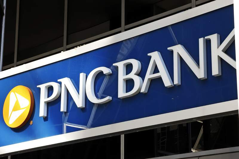 This is the sign on a PNC Bank branch in downtown Pittsburgh, Sunday, May 31, 2020. PNC Bank is the latest large U.S. financial services company to increase wages in a bid to keep and attract employees. It is raising its minimum wage to $18 an hour while also giving higher-paid workers a bump in pay. The bank said Monday, Aug. 30, 2021 that the wage increase will apply to both PNC employees as well as those working for BBVA USA, which PNC acquired last year. (AP Photo/Gene J. Puskar)