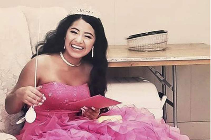 "In this February 2021 photo provided by Caring Place@ Miami Rescue Mission, Adriana Palma wears a tiara and ballgown on her quinceanera, her 15th birthday celebration. Quinceaneras are revered in Hispanic culture and celebrated with all the gusto of a wedding. But after her father lost his job, Adriana said, ""I lost all hope of having one."""
