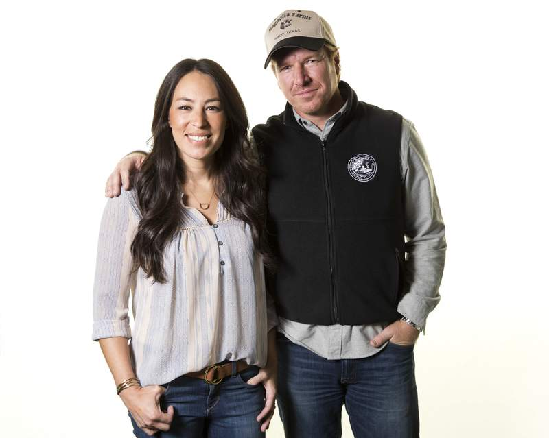 """FILE - In this March 29, 2016, file photo, Joanna Gaines, left, and Chip Gaines pose for a portrait in New York to promote their home improvement show, """"Fixer Upper,"""" on HGTV.  The Fixer Upper series, which ran for five seasons before airing its final episode in April 2018, is coming back and will air exclusively on Magnolia Network when it launches in 2021. (Photo by Brian Ach/Invision/AP, File)"""