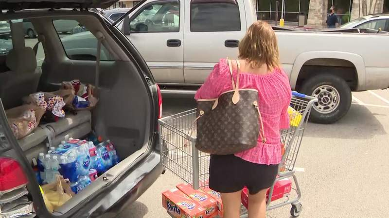 Last-minute shoppers rush out for supplies ahead of Hurricane Laura.