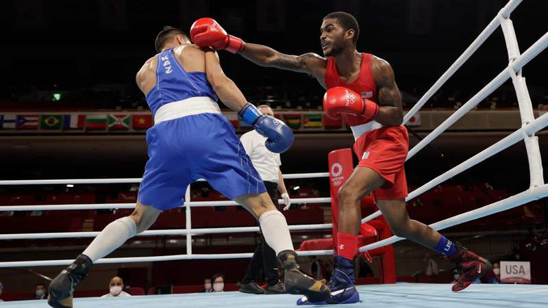 Delante Johnson throws a punch in the men's welterweight Round of 16 on Tuesday.