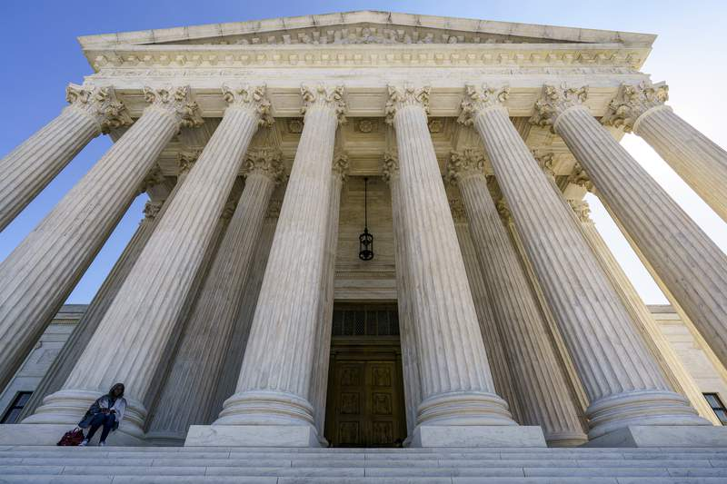 FILE - In this Oct. 7, 2020, file photo the Supreme Court in Washington. The Supreme Court has dismissed a case over former President Donald Trumps efforts to block critics from his personal Twitter account. Lower courts had ruled against Trump. But the justices said April 5, 2021, there was nothing left to the case after Trump was permanently suspended from Twitter and ended his presidential term in January. (AP Photo/J. Scott Applewhite, File)