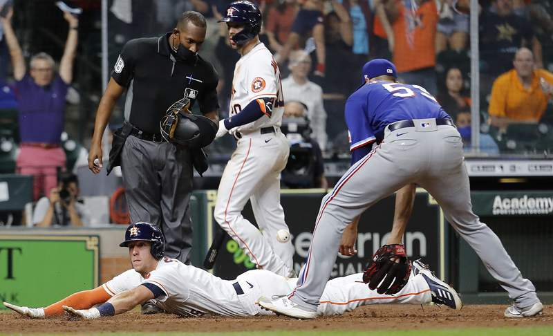 HOUSTON, TEXAS - MAY 13: Myles Straw #3 of the Houston Astros scores on a wild pitch by Brett Martin #59 of the Texas Rangers in the eleventh inning at Minute Maid Park on May 13, 2021 in Houston, Texas. (Photo by Bob Levey/Getty Images)
