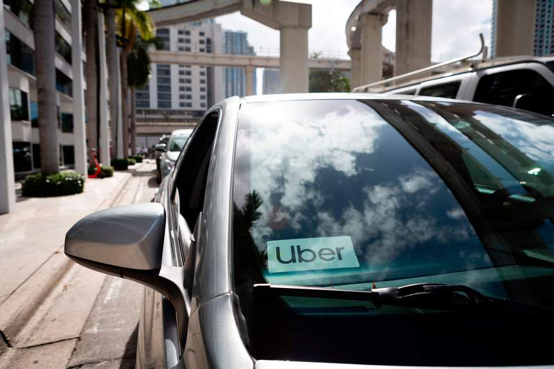 An Uber sticker is seen on a car windshield on the street in downtown Miami on January 9, 2020. - Every year, the American football season ends with the vast spectacle of the Super Bowl, drawing in celebrity superstars, hugely expensive advertising and 100 million viewers.But the sporting mega-event also has a darker side: a spike in human trafficking, in particular a rise in sexual exploitation. This year, Miami will host the Super Bowl on February 2, but the party city in southern Florida -- already the state with the third highest rate of human trafficking in the country, after California and Texas -- worries that the combination of the huge sport event in proximity to its world-famous beaches and clubs will create a perfect storm of sex trafficking. (Photo by Eva Marie UZCATEGUI / AFP) (Photo by EVA MARIE UZCATEGUI/AFP via Getty Images)