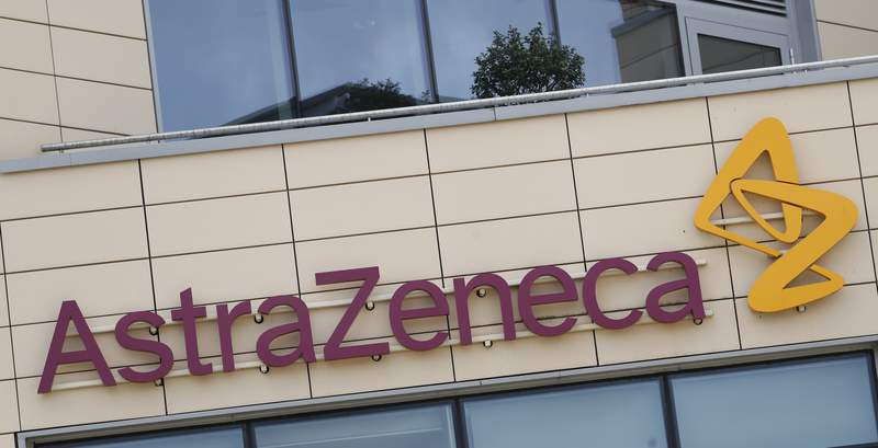FILE - This Saturday, July 18, 2020 file photo shows a general view of AstraZeneca offices and the corporate logo in Cambridge, England. Oxford University says on Saturday, Sept. 12 trials of a coronavirus vaccine that it is developing with pharmaceutical company AstraZeneca will resume, days after being paused due to a reported side-effect in a patient in the U.K. The university said in large trials such as this it is expected that some participants will become unwell and every case must be carefully evaluated to ensure careful assessment of safety. (AP Photo/Alastair Grant, file)