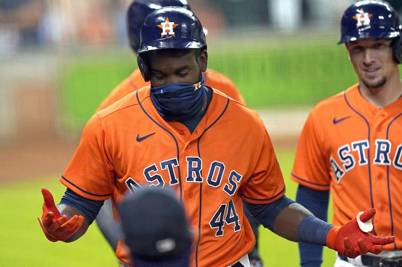Houston Astros' Yordan Alvarez (44) gestures as he walks back to the dugout after hitting a three-run home run against the Seattle Mariners during the first inning of a baseball game Friday, Aug. 14, 2020, in Houston. (AP Photo/David J. Phillip)