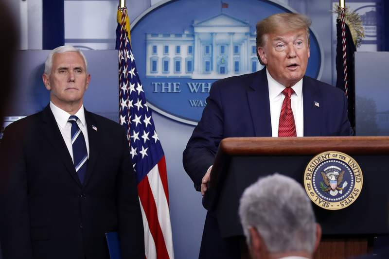 President Donald Trump speaks about the coronavirus in the James Brady Press Briefing Room of the White House, Thursday, April 16, 2020, in Washington, as Vice President Mike Pence listens. (AP Photo/Alex Brandon)