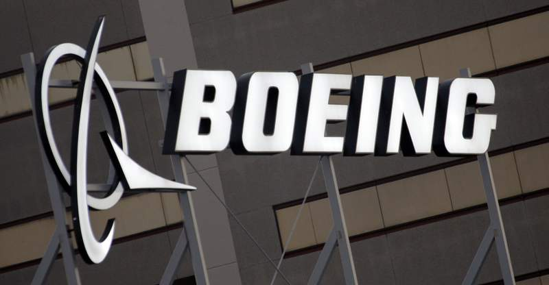 FILE - In this Jan. 25, 2011, file photo, is the Boeing Company logo on the property in El Segundo, Calif. Safety regulators issued an emergency order on Thursday, July 23, 2020, directing airlines to inspect and if necessary replace a critical engine part on popular Boeing 737 jets after four reports of engines shutting down during flights. The Federal Aviation Administration said its order affected about 2,000 twin-engine passenger jets in the United States. (AP Photo/Reed Saxon, File)