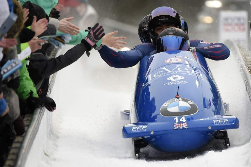 Team Brad Hall, Lawrence Taylor, Luke Dawes and Greg Cackett of Britain arrive the finish area during the four-man bobsled race at the Bobsleigh and Skeleton World Championships in Altenberg, eastern Germany, Sunday, March 1, 2020. (AP Photo/Jens Meyer)