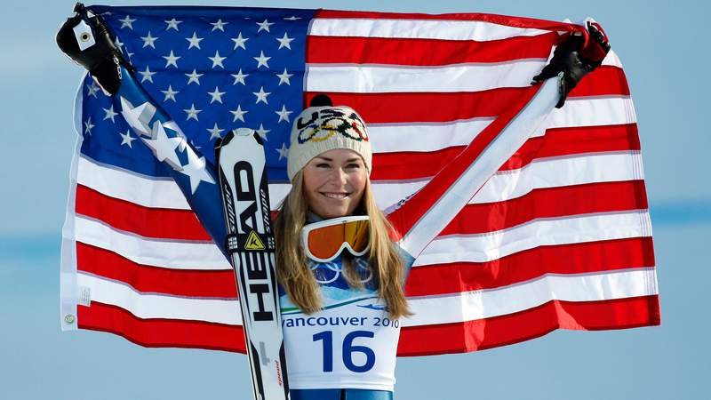 Lindsey Vonn (USA) celebrates after winning the women's downhill gold medal at the 2010 Vancouver Winter Olympics.
