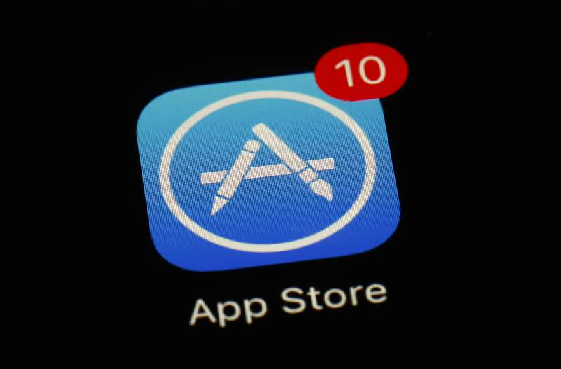 FILE - This March 19, 2018, file photo shows Apple's App Store app in Baltimore. Apple has agreed to let developers of iPhone apps email their users about cheaper ways to pay for digital subscriptions and media by circumventing a commission system that generates billions of dollars annually for the iPhone maker. The concession announced late Thursday, Aug. 26, 2021 is part of a preliminary settlement of a nearly 2-year-old lawsuit filed on behalf of iPhone app developers in the U.S. (AP Photo/Patrick Semansky, File)