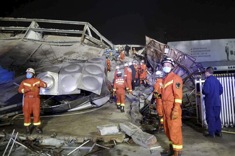 Rescuers work at the site of a collapsed five-story hotel building in Quanzhou city in southeast China's Fujian province Saturday, March 7, 2020. The hotel used for medical observation of people who had contact with coronavirus patients collapsed in southeastern China on Saturday, trapping dozens, state media reported. (Chinatopix Via AP)