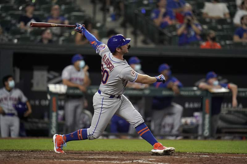 New York Mets designated hitter Pete Alonso watches his ball while hitting a solo home run off Baltimore Orioles relief pitcher Travis Lakins Sr., during the ninth inning of a baseball game, Tuesday, June 8, 2021, in Baltimore. The Orioles won 10-3. (AP Photo/Julio Cortez)