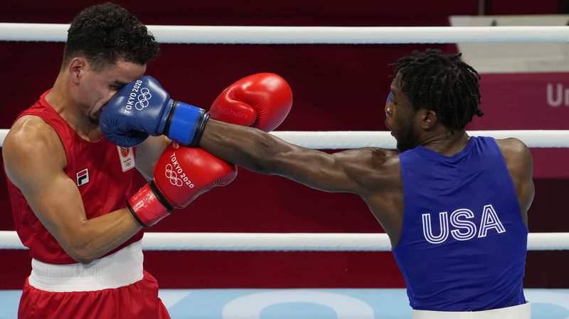 Keyshawn Davis lands a punch in his bout against the Netherlands' Enrico Lacruz.
