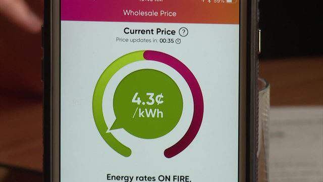 The Griddy app displays the current wholesale electricity price on a phone in this 2019 file photo.