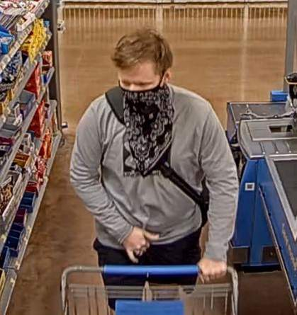 Suspect caught on surveillance camera stealing from a Walmart in The Woodlands.