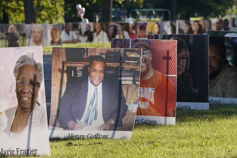 FILE - In this Monday, Aug. 31, 2020 file photo, some of the nearly 900 large poster-sized photos of Detroit victims of COVID-19 are displayed on Belle Isle in Detroit. The COVID-19 pandemic pushed total U.S. deaths last year beyond 3.3 million, the nations highest-ever annual death toll, the government reported Wednesday, March 31, 2021. (AP Photo/Carlos Osorio)