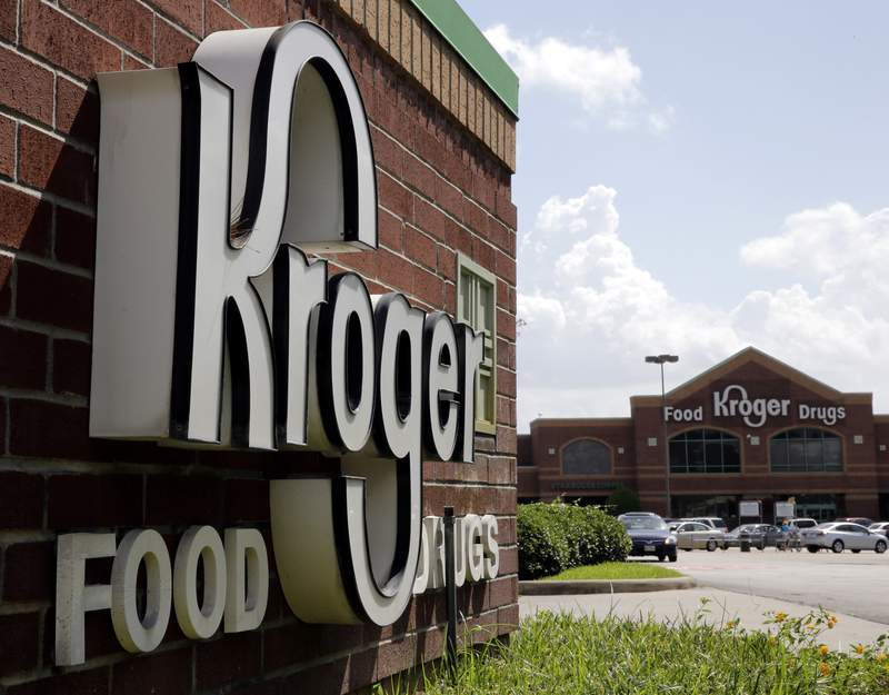 FILE - This June 17, 2014, file photo, shows a Kroger store in Houston. Billionaire Warren Buffett's company has again increased the size of its bet on grocery giant Kroger, while scaling back several of its health care industry investments. Berkshire Hathaway Inc. said in a quarterly update with regulators Monday, Aug. 16, 2021, that it picked up nearly 11 million shares of Kroger stock during the second quarter, raising its holdings to 61.8 million shares. Buffett's company has been steadily adding to its Kroger holdings in recent quarters. (AP Photo/David J. Phillip, File)