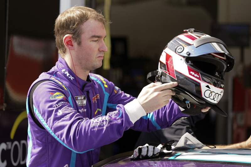 FILE - Cody Ware gets ready for a NASCAR Daytona 500 auto race practice session at Daytona International Speedway in Daytona Beach, Fla., in this Wednesday, Feb. 10, 2021, file photo. Ware will make his IndyCar debut at Road America this weekend driving a car for Dale Coyne Racing that has an association with Ware's father. (AP Photo/John Raoux, File)