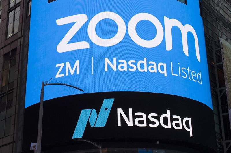 FILE - This April 18, 2019, file photo shows a sign for Zoom Video Communications ahead of their Nasdaq IPO in New York. A U.S. government committee that reviews foreign investment in telecom is probing videoconferencing company Zooms $14.7 billion deal for cloud call center company Five9 for national security risks due to foreign participation. The Justice Department declined to answer questions Tuesday, Sept. 21, 2021. (AP Photo/Mark Lennihan, File)