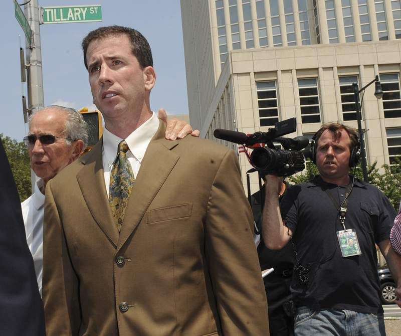 FILE - In this July 29, 2008, file photo, former NBA referee Tim Donaghy exits Brooklyn federal court following his sentencing after pleading guilty to federal charges that he took payoffs from a professional gambler for inside tips on games. The disgraced former NBA referee is back, and again this time hes fixing the result, only with his employers permission. Donaghy made his debut for Major League Wrestling this week in nefarious fashion. (AP Photo/Louis Lanzano, File)