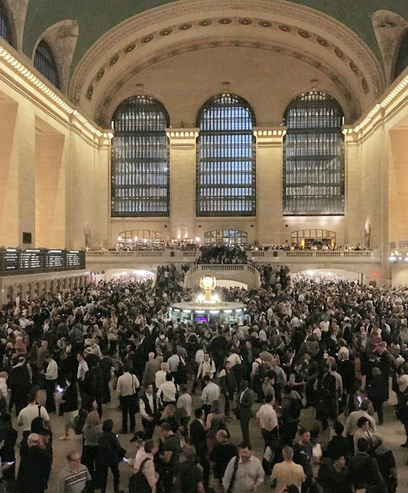 Commuters crowd the Grand Central Terminal in New York on Tuesday, May 15, 2018. Asian American households saw the biggest income growth of any racial or ethnic group in the United States over the past decade and a half _ almost 8%. New figures released Thursday, Dec. 10, 2020 by the U.S. Census Bureau also show that household income for Latinos grew by almost 6% over that time. (AP Photo/Donald King, file)