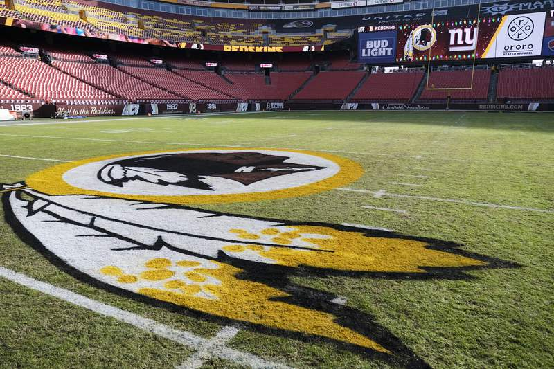 FILE - In this Dec. 22, 2019, file photo, the Washington Redskins logo is seen on FedEx Field prior to an NFL football game between the New York Giants and the Redskins in Landover, Md. Washington state Attorney General Bob Ferguson says Seattle-based Amazon will begin pulling Redskins team merchandise from its online marketplace. Ferguson urged the online giant to remove such merchandise it because of growing calls for the team to change what he called their use of a racial slur in the name. (AP Photo/Mark Tenally, File)