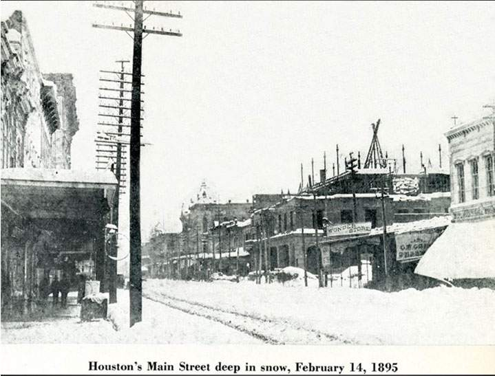 This image provided by the National Weather Service in Houston shows snow-covered streets in Houston on Feb. 14, 1895.