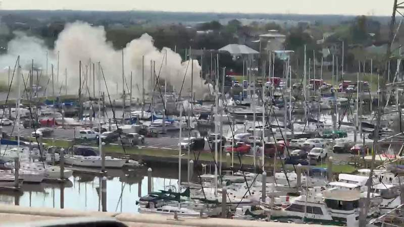 Smoke rises from the scene of a boat fire in Clear Lake Shores, Texas, on Dec. 4, 2020.