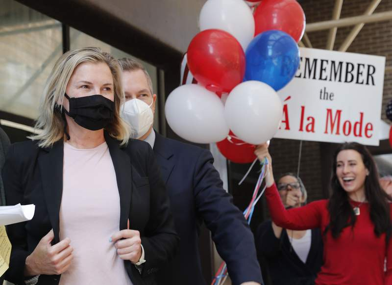 Salon owner Shelley Luther, left, walks over to speak to the media and supporters after she was released from jail in Dallas, Thursday, May 7, 2020. Luther was jailed for refusing to keep her business closed amid concerns of the spread of COVID-19. (AP Photo/LM Otero)