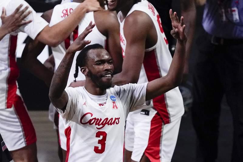Houston guard DeJon Jarreau (3) celebrates beating Houston 67-61 after an Elite 8 game in the NCAA men's college basketball tournament at Lucas Oil Stadium, Monday, March 29, 2021, in Indianapolis. (AP Photo/Michael Conroy)