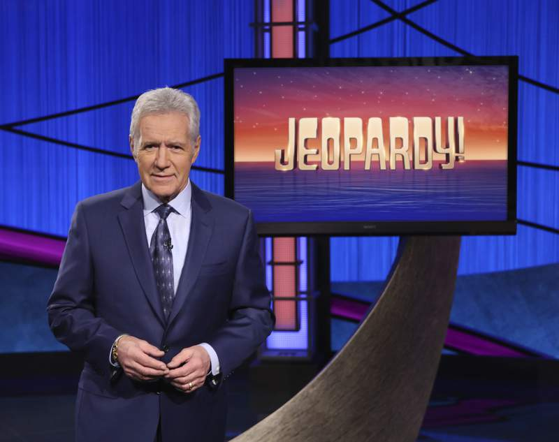 """FILE - This image released by Jeopardy! shows Alex Trebek, host of the game show """"Jeopardy!"""" Trebeks final week of episodes will air Monday, Jan. 4 through Friday, Jan. 8, 2021. All five episodes were taped in late October. (Jeopardy! via AP)"""