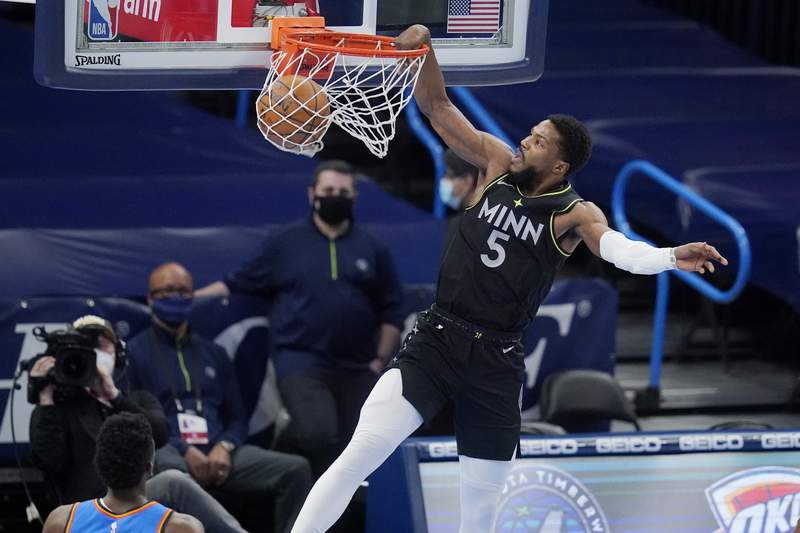 Minnesota Timberwolves guard Malik Beasley (5) dunks in front of Oklahoma City Thunder guard Hamidou Diallo, left, in the first half of an NBA basketball game Friday, Feb. 5, 2021, in Oklahoma City. (AP Photo/Sue Ogrocki)
