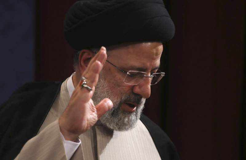In this June 21, 2021, photo, Iran's new President-elect Ebrahim Raisi waves at the conclusion of his news conference in Tehran, Iran. Biden administration officials are insisting that the election of a hard-liner as Irans president wont affect prospects for reviving the faltering 2015 nuclear deal with Tehran. But there are already signs that their goal of locking in a deal just got harder. (AP Photo/Vahid Salemi)