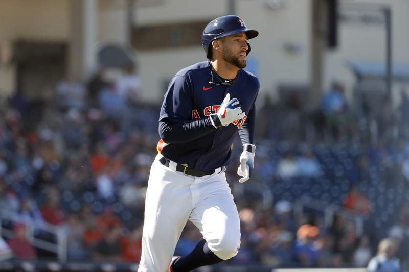 Houston Astros' George Springer runs toward first on a ground out during the fifth inning of a spring training baseball game against the New York Mets Saturday, Feb. 29, 2020, in West Palm Beach, Fla. (AP Photo/Jeff Roberson)